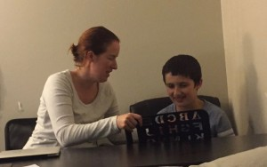 Jill and her son Tommy using a letter board for Rapid Prompting Method (RPM)